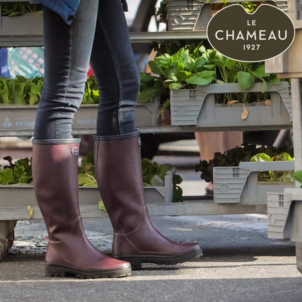 Frau mit Le Chameau Stiefeln
